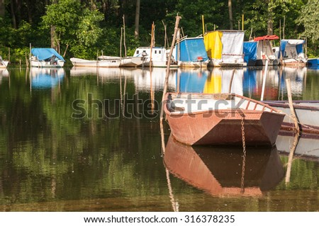 METAL FISHING BOAT ON THE RIVER. - stock photo