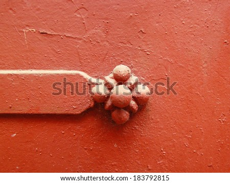 Metal flower on rusty metal, textural background - stock photo