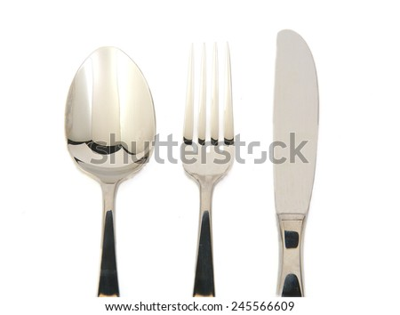 Metal fork, knife and spoon on white background - stock photo
