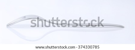 metal fork on white background