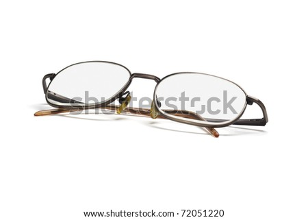 Metal frame eye glasses isolated on white background - stock photo