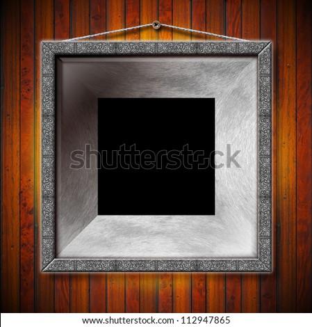 metal frame on a old wood wall empty metallic frames on a old dark wooden - Metal Picture Frames
