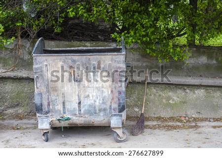 Metal garbage container. Four wheeled trash - stock photo