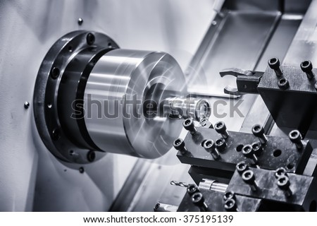 metal gear turning, CNC milling machine close-up - stock photo