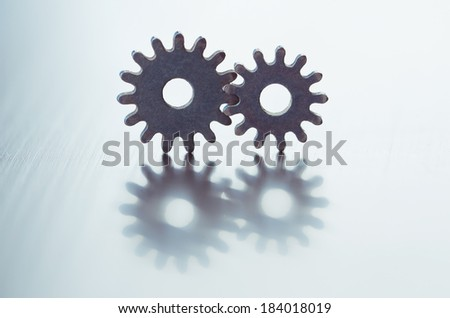Metal gears. Close-up of two steel gears linked concept for love, family, teamwork and partnership - stock photo