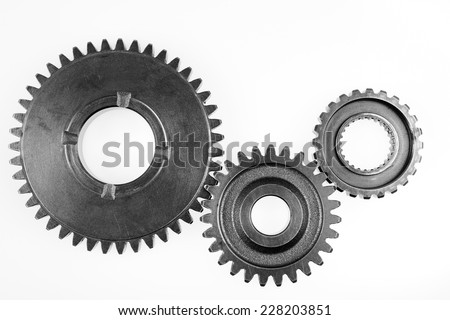 Metal gears on plain background - stock photo