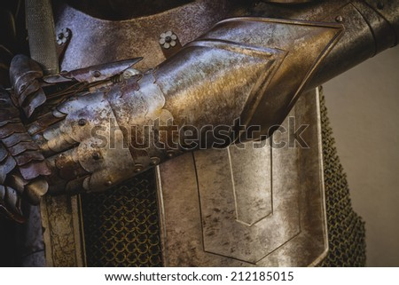 metal gloves, medieval armor made of wrought iron - stock photo