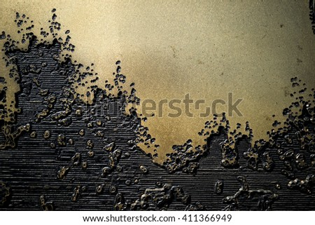 Metal, gold (bronze) surface with black engraving lines, creating an interesting pattern. It can be used as the background or texture for any photo editor  - stock photo
