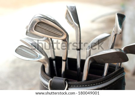 metal golf clubs in bag   - stock photo