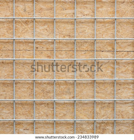 Metal grid and wooden board texture - stock photo