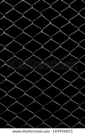 metal grid on a black background - stock photo