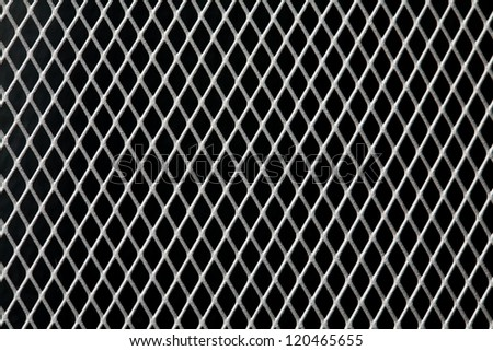 metal grid on black background - stock photo