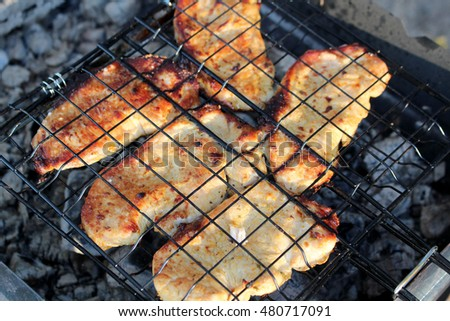 Metal grill for barbecue on dark background