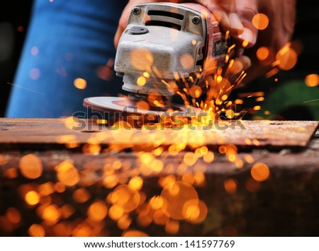 Metal grinding on steel sheet close up - stock photo