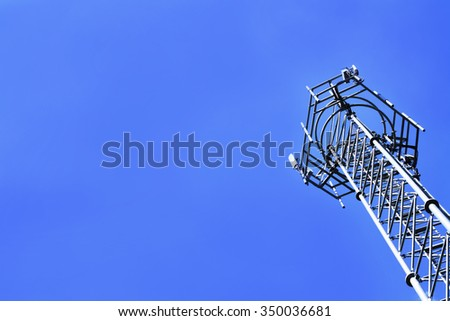 metal GSM tower and clearly blue sky - stock photo