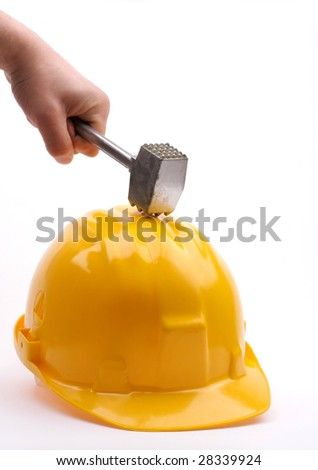 metal hammer hit the helmet - stock photo