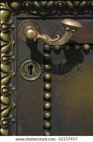 Metal handle on metal door - stock photo