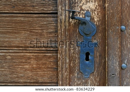 metal handle on the old door - stock photo