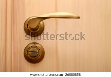 metal handle on wooden door - stock photo
