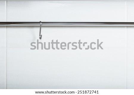 Metal hook on a chromed tube. - stock photo