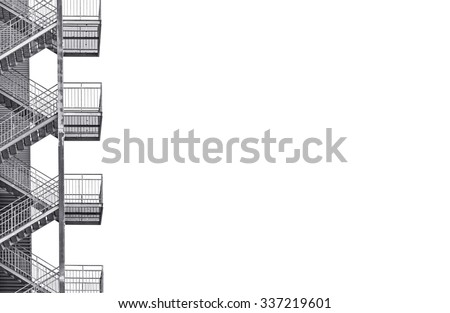 Metal industrial staircase isolated on white background. Black and white picture with plenty of copy space on the right - stock photo
