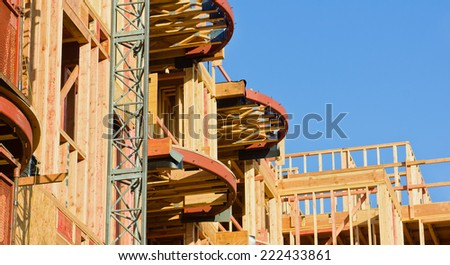 Metal is used to give shape and design to a wood frame building.  - stock photo