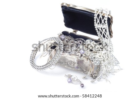 Metal jewelry open box with accessory on white background - stock photo
