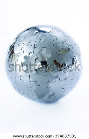 Metal jigsaw puzzle globe on white background
