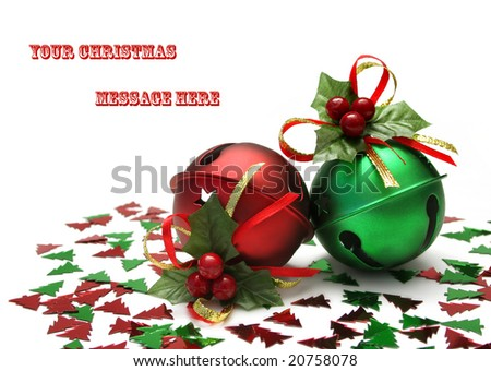 Metal Jingles Bells with holly bows and christmas tree shaped glitter on a white  background, and space for text - stock photo