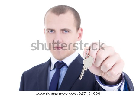 metal key in male real estate agent hand isolated on white background - stock photo