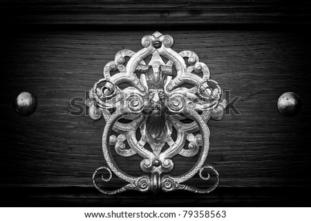 metal knocker in black and white - stock photo
