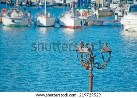 metal lamppost by Alghero harbor - stock photo