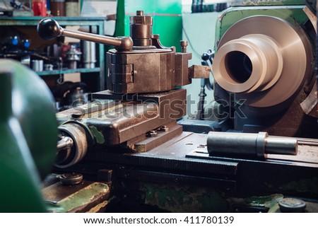 Metal lathe machinery tool equipment in workshop - stock photo
