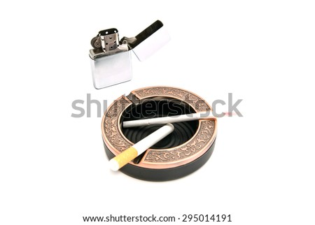 metal lighter and different cigarettes in the ashtray - stock photo