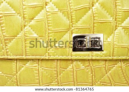 Metal lock on leather bag - stock photo