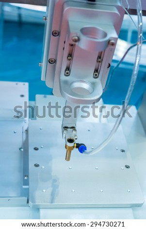 Metal machining equipment with high precision tools,High technology robotic arm - stock photo