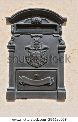 Metal mailbox on wall - stock photo