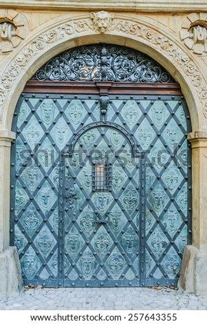 Metal massive door in an ancient fortress Europe. - stock photo