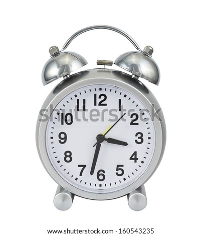 Metal mechanical alarm clock isolated over white background - stock photo