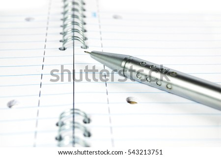 Metal mechanical pencil on a spiral-bound notepad