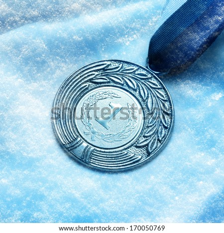Metal medal on snow background - stock photo