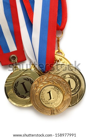 Metal medals with tricolor ribbon