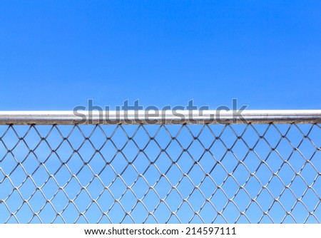 Metal mesh and blue sky background