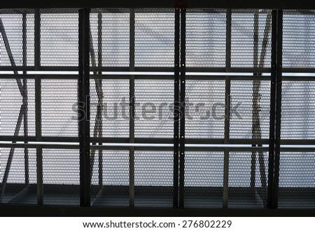 Metal mesh framework against the gray sky background - stock photo