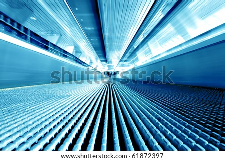 metal modern travelator in moving inside airport - stock photo