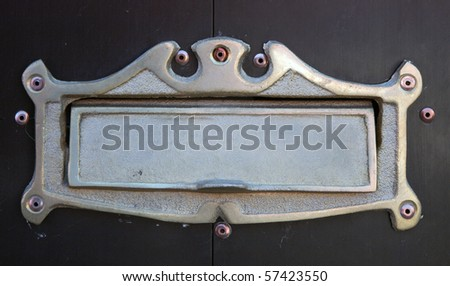 Metal nameplate on wooden door, in Oaxaca - stock photo