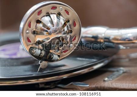 Metal needle of retro record player - stock photo