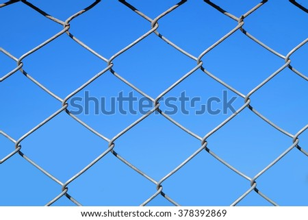 metal net with blue sky background