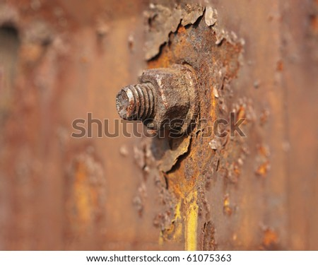 Metal nut rusted under the influence of water and air - stock photo