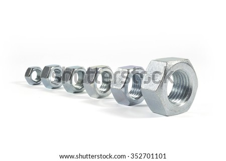 Metal Nuts Lined Up From Smallest To Largest Isolated On White Background